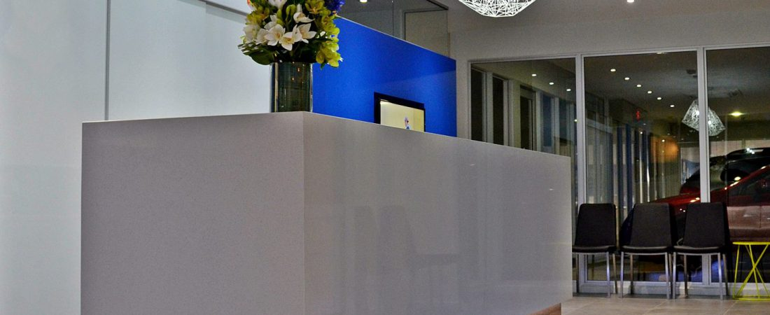 Custom built bespoke office interior featuring a beautiful reception counter and lighting