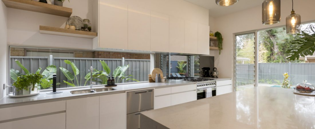 Custom built interior kitchen in Adelaide featuring stone counters and drop down lighting