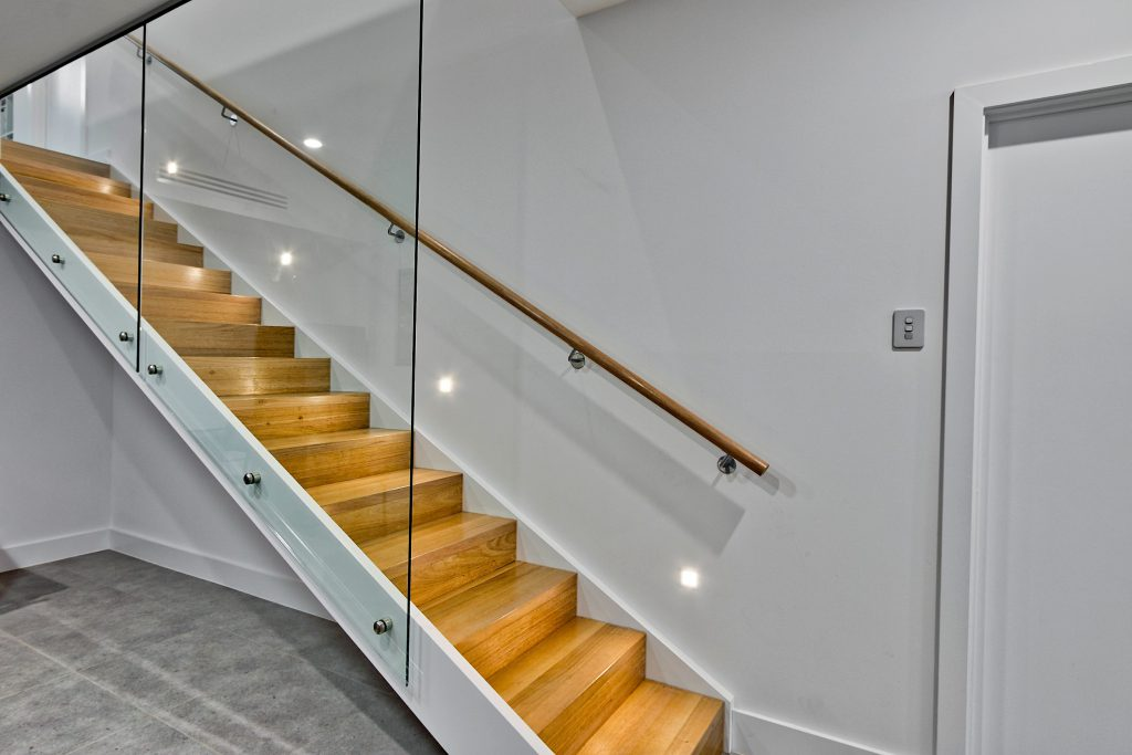 No longer an unfinished home: modern staircase with glass panels